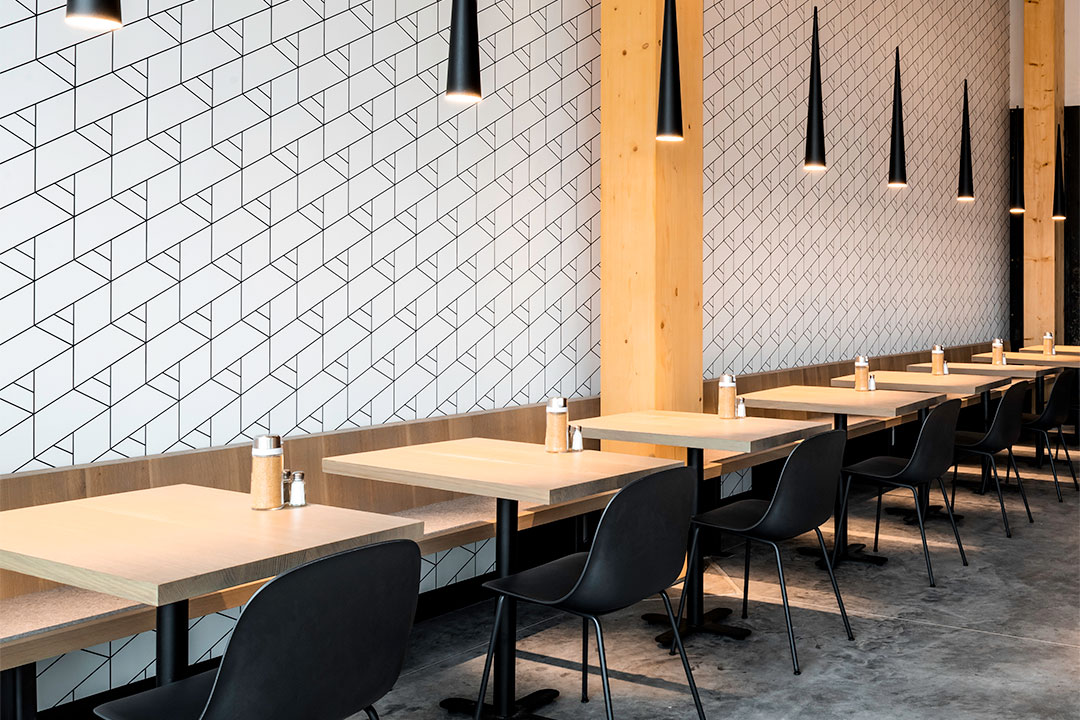 Cafe style banquette seating along wall